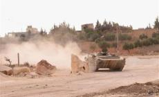 A Syrian army tank is seen in the Khan al-Assal area after clashes between Free Syrian Army fighters and forces loyal to Syria's President Bashar al-Assad, near Aleppo city