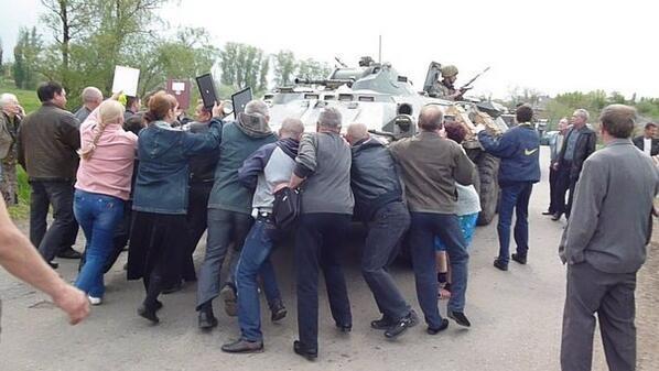 http://journal-neo.org/wp-content/uploads/2014/05/ukraine-Civilians-East-in-East-Ukraine-Form-Human-Chain-to-Block-Armored-vehicles.jpg