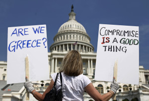 A demonstrator holds placards to protest U.S. debt in front of the Capitol in Washington