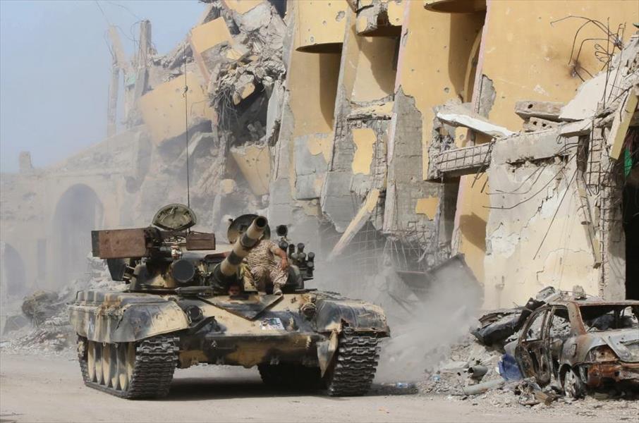 تقرير برلماني بريطاني:ليبيا هي الكوارث الغربية كاملة Get_img