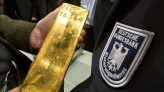 Gold or Gunfire: Hedging Against the Collapse of the Dollar